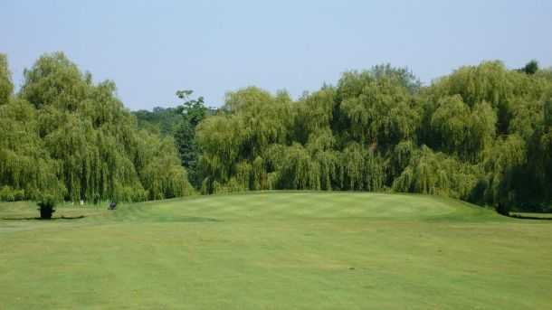 The sloping 6th green at Bush Hill Park