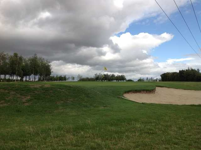 The 4th green and greenside bunker at South Cerney Golf Club