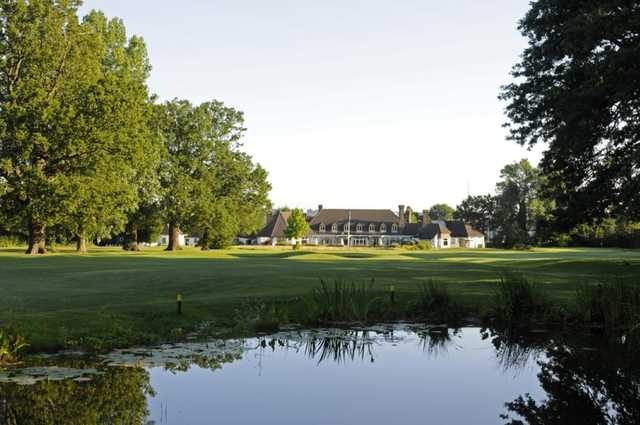 Beautiful view across the pond of the 18th green with the clubhouse in the background at Shirley Park Golf Club
