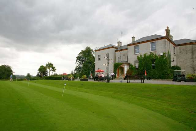 View of the clubhouse and putting green at Elmgreen Golf Club