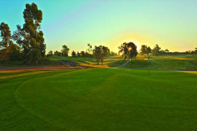 Sunset view of a green at The Golf Club at Rancho California