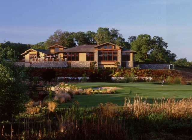 View of the clubhouse and the finishing hole at Whitney Oaks Golf Club
