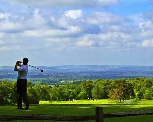 Golfer teeing at Crowborough Beacon Golf Club