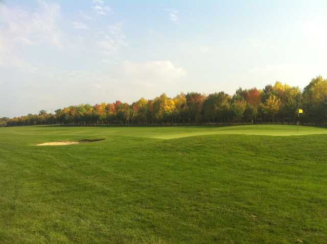 Image of lush fairway and green at Waterstock Golf Club