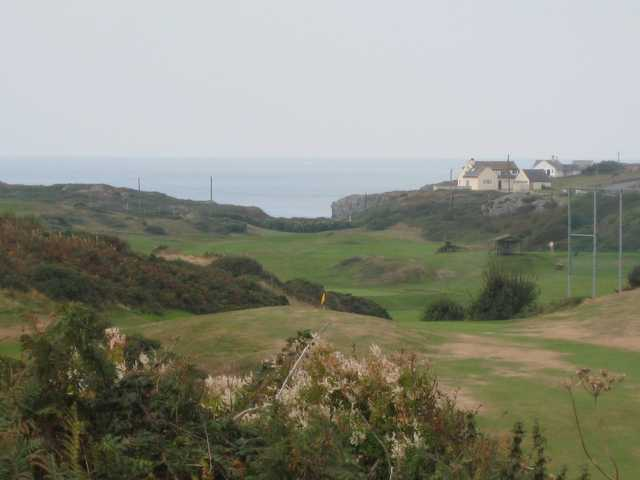 Beautiful view of the 1st hole overlooking the sea at Holyhead Golf Club