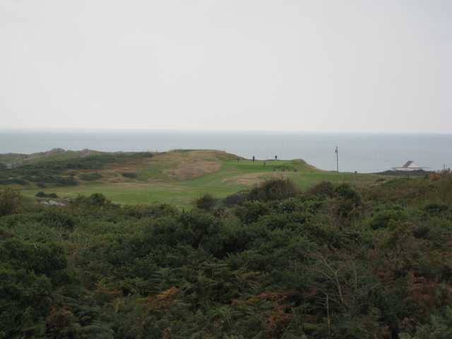 View of the 3rd green and ocean backdrop at Holyhead Golf Club