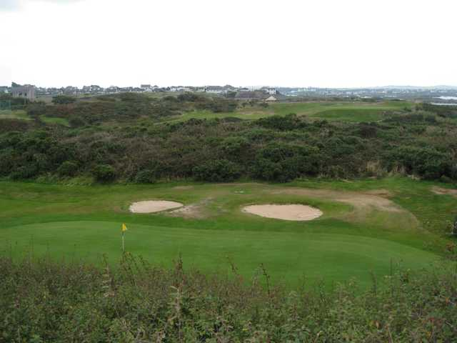 View of the 9th green and neighbouring villages at Holyhead Golf Club