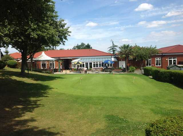 On the putting green at The Oaks Golf Centre