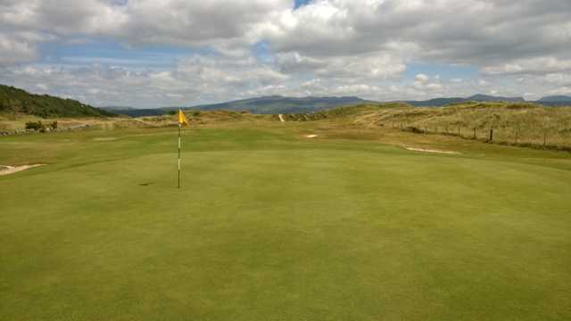 A scenic view of the 14th green at Porthmadog Golf Club