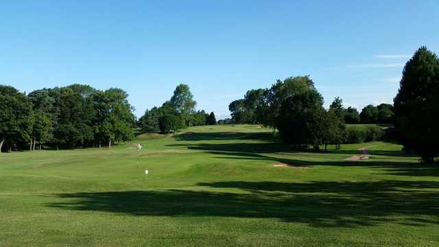 A scenic view of the 18th hole at Vicars Cross Golf Club