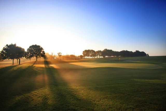 Sunrise over the perfectly manicured course at Stockley Park Golf