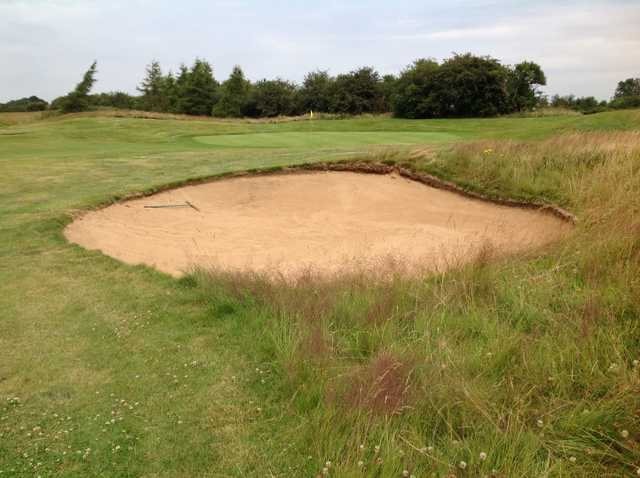 The 3rd green and greenside bunker at Kilworth Springs Golf Club
