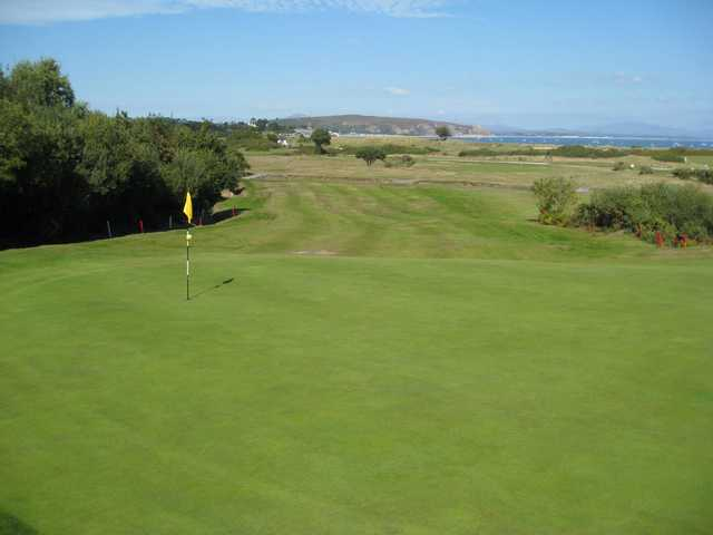 A view of the 2nd green and surrounding sea at Abersoch GC