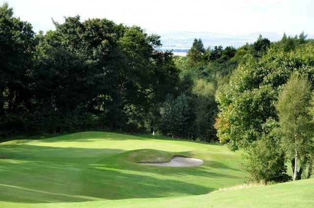 Downhill approach shot to a small green at Baberton GC