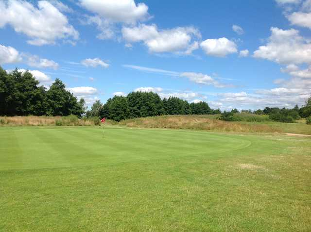 A view of the 1st green at Hurtmore Golf Club