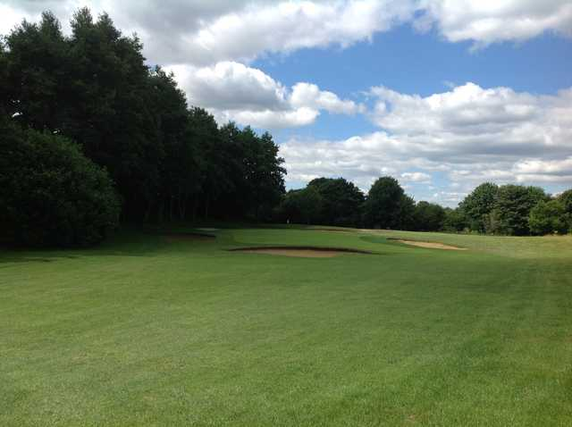 The tree lined 16th approach at Hurtmore Golf Club