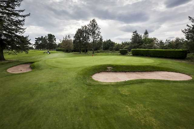 The 12th green on the Alyth Golf Course with surrounding bunkers