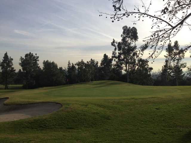 View of a green and bunker at Marshall Canyon Golf Club