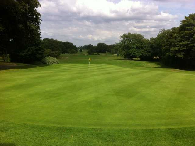 The 18th green at Sale Golf Club
