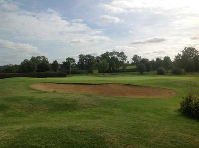 Large bunker protecting the 9th green at Stoke Albany Golf Club