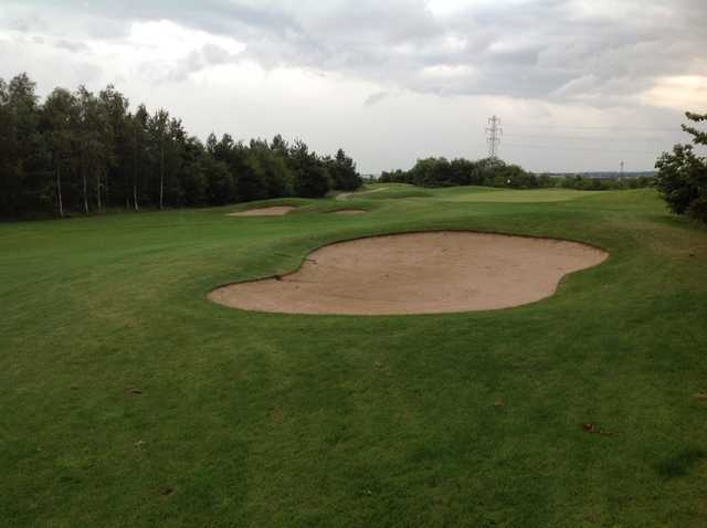 The 2nd green and surrounding bunkers at Waterfront Golf Club