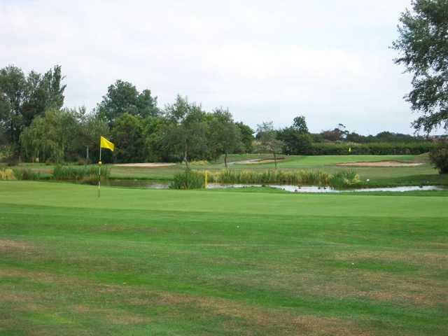 Gently sloping velvet green on Clancton-on-Sea's 16th hole