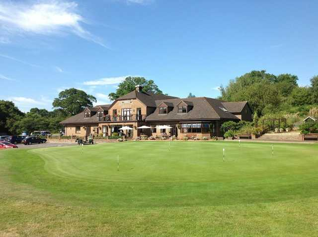 A view of the magnificent clubhouse overlooking the putting green at Chobham Golf Club