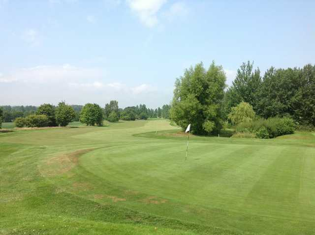 A scenic view of the 18th green and fairway at Lindfield Golf Club
