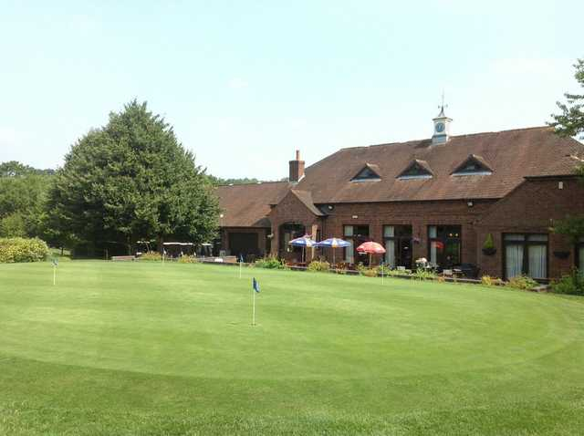 The putting green and clubhouse at Lindfield Golf Club