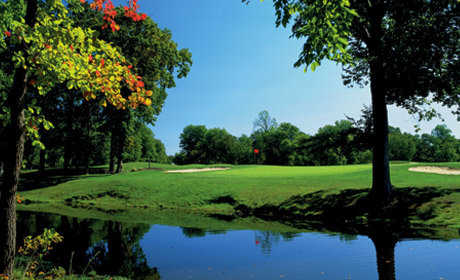 A view of green surrounded by water atRancocas Golf Club