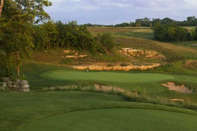 Sunset view of a bunkered green at Stone Canyon Golf Club