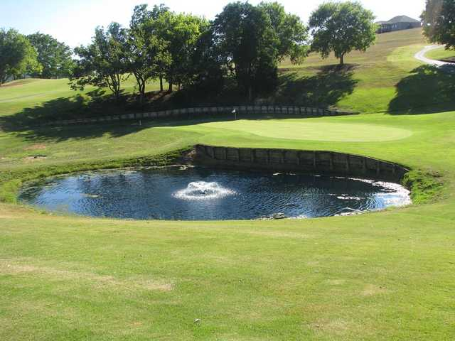 View of a green and pond at Patriot Hills Golf Club