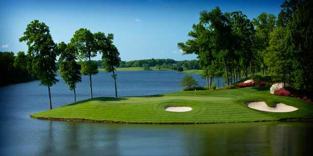 A view of a green surrounded by water at Robert Trent Jones Golf Club