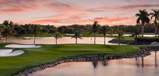 A view of a green surrounded by water from Flamingo Island Course at Lely Resort Golf & Country Club