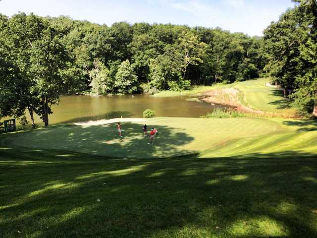 A sunny day view of a hole at The Club from Porto Cima