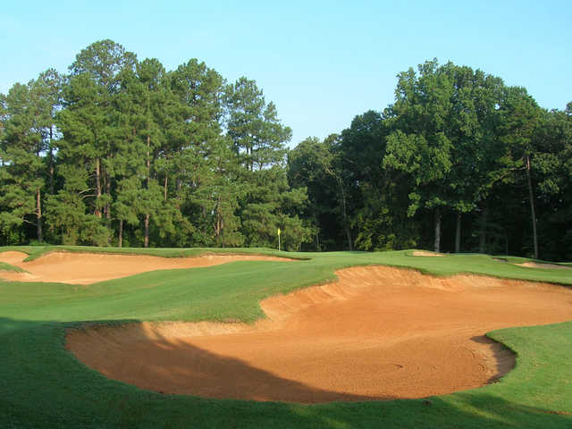 A view of the 17th green protected by tricky bunkers at Championship Course from Tanglewood Golf Club