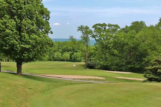 View of a bunkered green at Sleepy Hollow Country Club