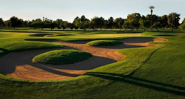 A view of the old layout of the 14th green guarded by tricky bunkers at Blue Course from Wigwam Resort