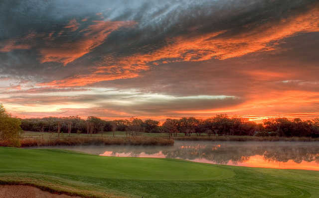 Sunset view of a green at Grey Rock Golf Club