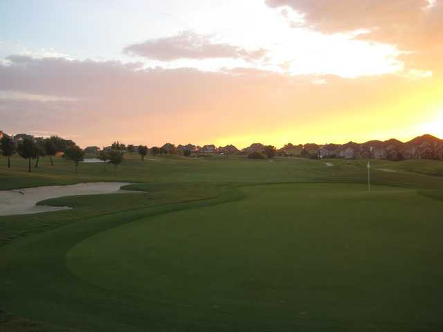Sunset view of a green at Coyote Ridge Golf Club.