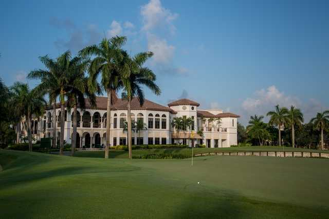 A view of a green and the clubhouse in background at Royal Palm Yacht & Country Club