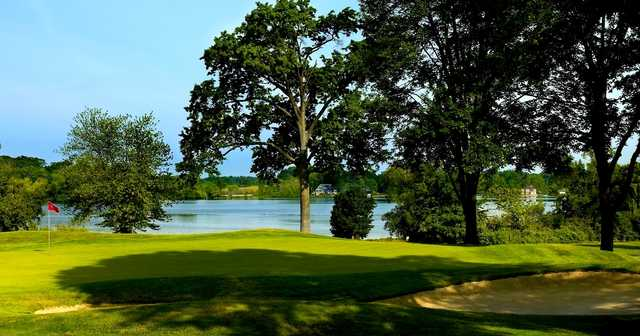 A view of a hole with water in background at Congress Lake Club