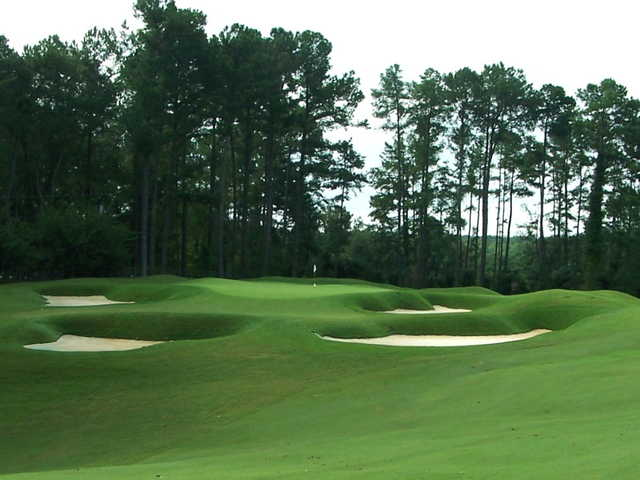 A view of a green protected by elegant bunkers at Country Club of Spartanburg