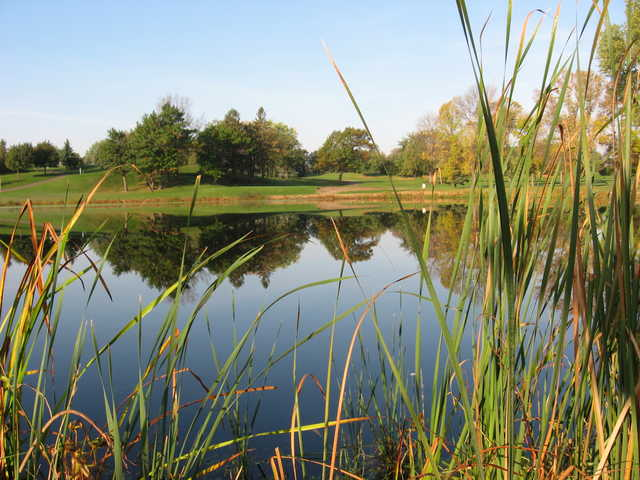 View of a green over water at Greenhaven Golf Course
