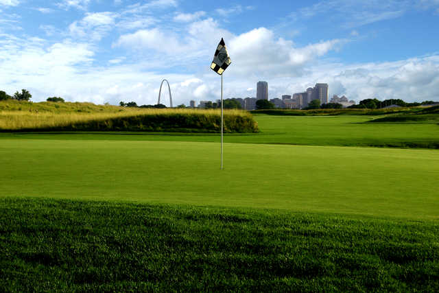 View of a green with St. Lois skyline in the background