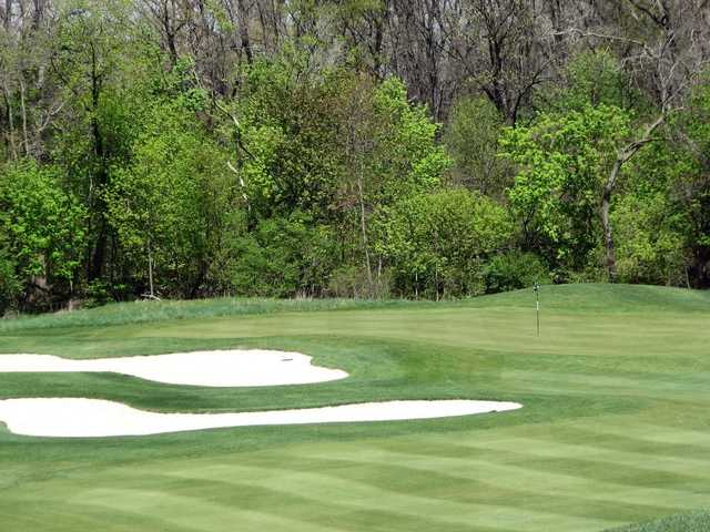 A spring view of a hole surrounded by sand traps at Monroe Golf & Country Club