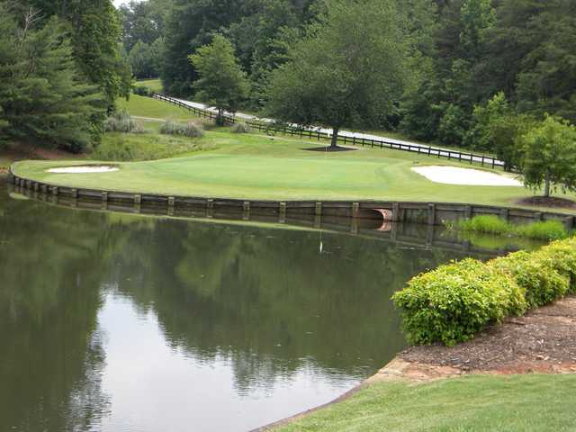 View of the signature hole - number 6 - at Village Greens Golf & Country Club
