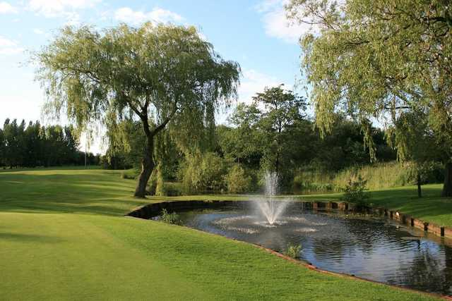 View of the pond to the left of the 4th green at Denton Golf Club