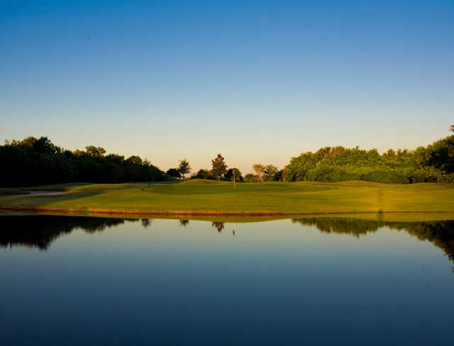 A view over the water of a hole at Suntree Country Club