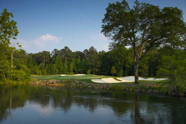 A view over the water of the 8th green at Palmer Island Nine from Champions Retreat Golf Club